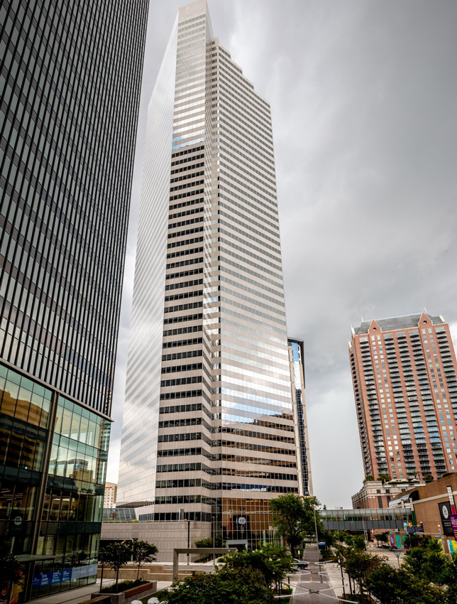 Exterior view of Fulbright Tower during the day with overcast