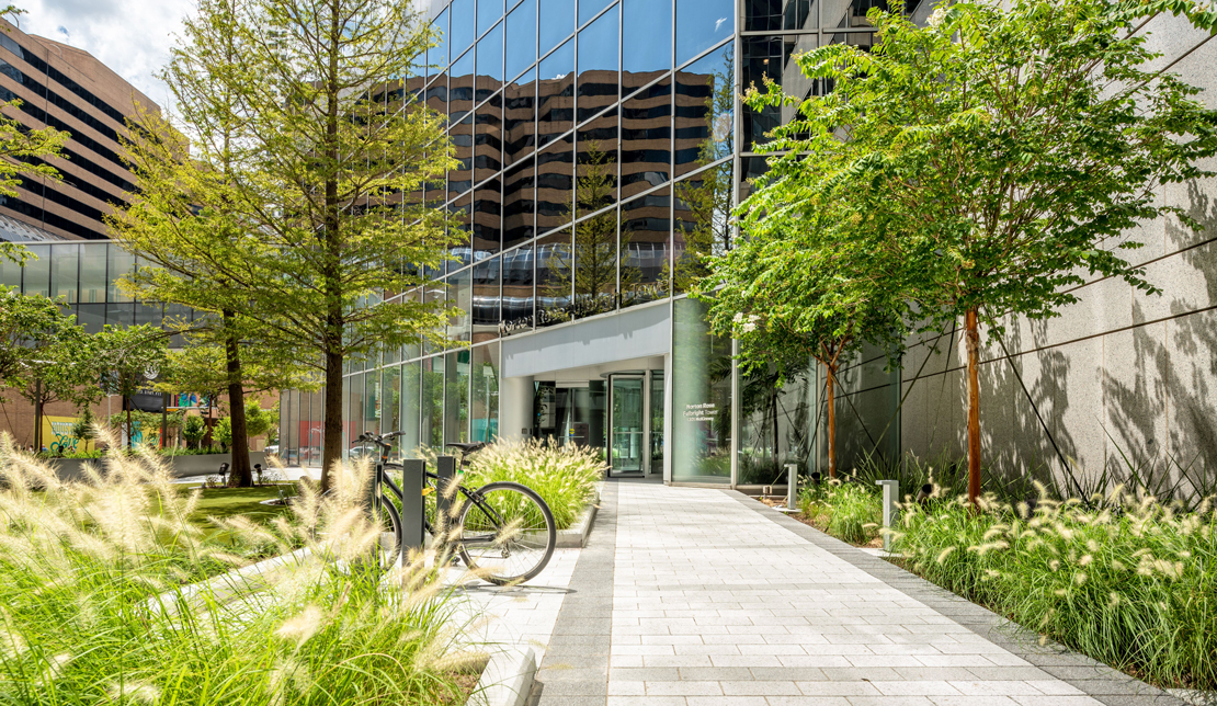 Exterior view of Fulbright Tower common area and outdoor seating area and sidewalks
