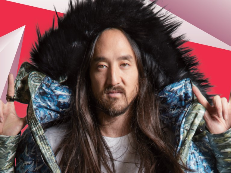 DJ, Steve Aoki, wearing coat with black fur hood