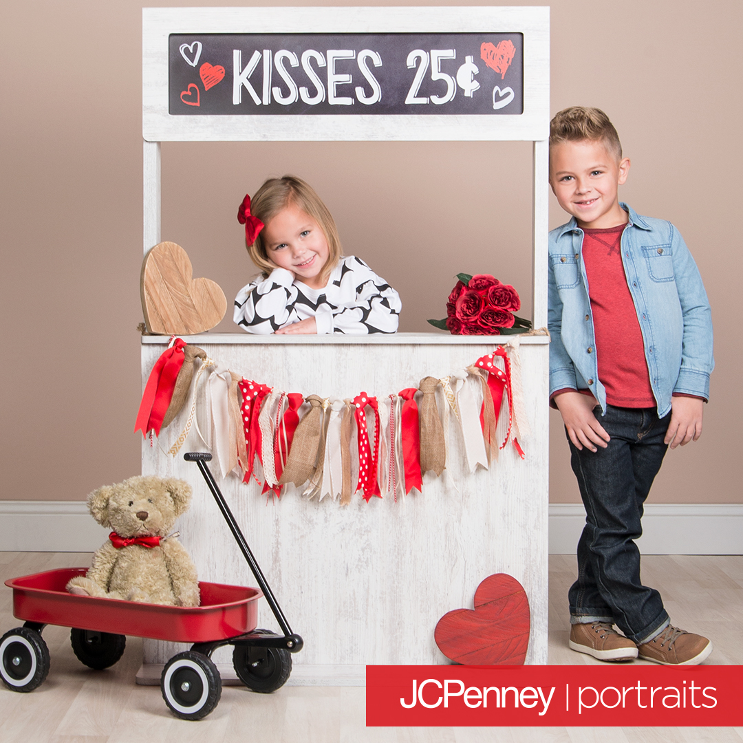 2 kids with kissing booth