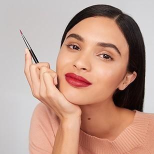 Girl holding makeup brush