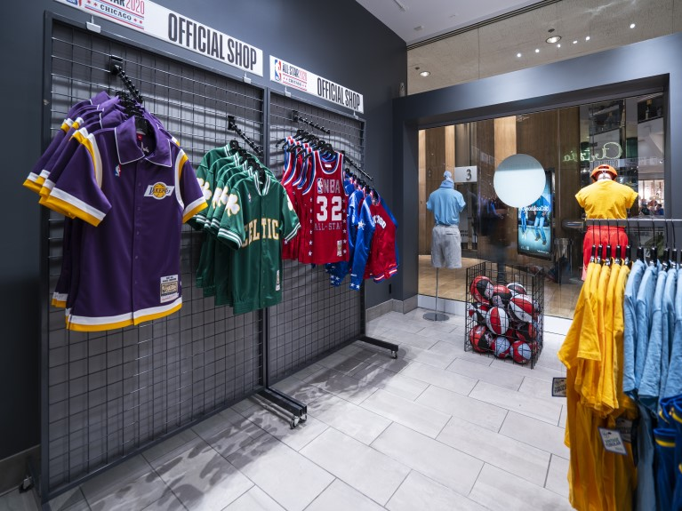 NBA merchandise hanging on the wall and on stands