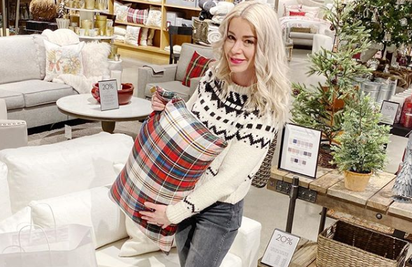pottery barn with ana haqq holding a pillow