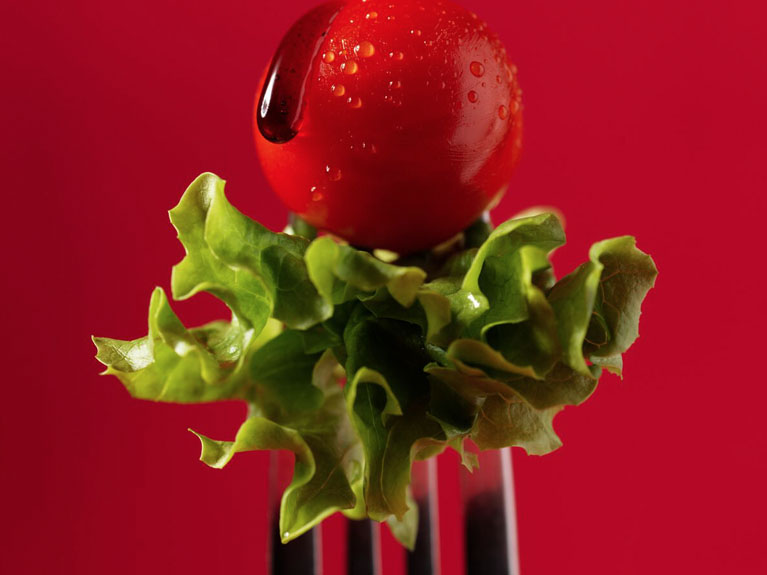 fork with lettuce and cherry tomato