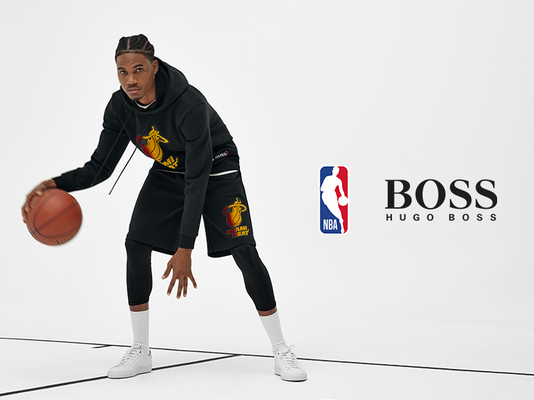 basketball player dribbling ball with Boss and NBA logo to the right side
