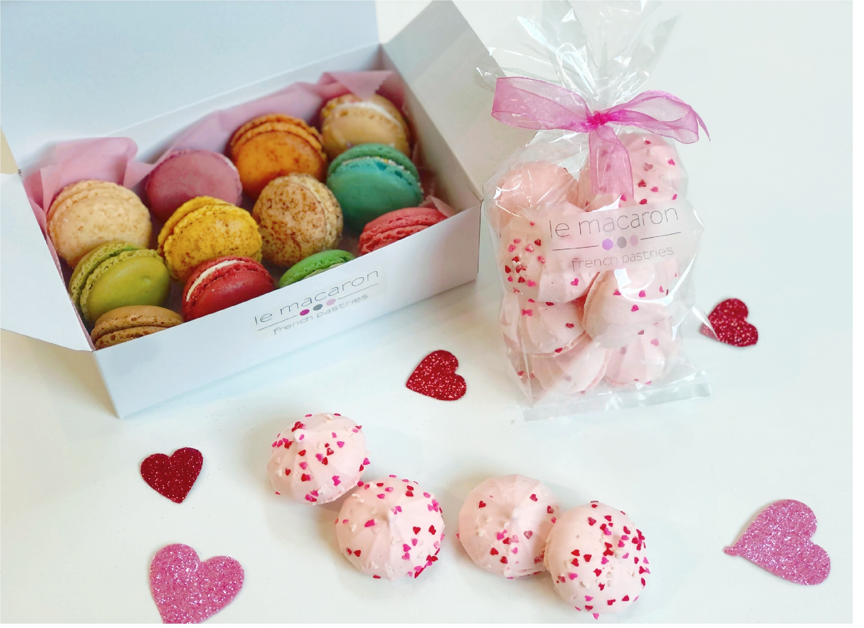 Buy 1 box 12 macarons, get one free small Valentines meringues bag from Le Macaron